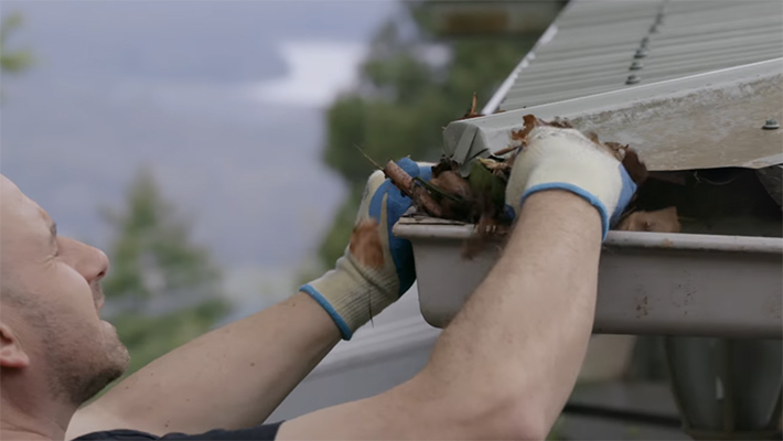 Clearing gutters before a bushfire
