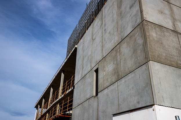 Partially constructed building with pre-cast concrete panels