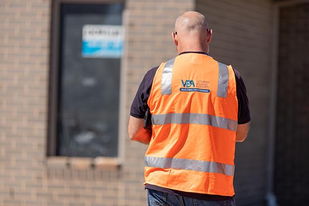 VBA inspector outside a newly built house