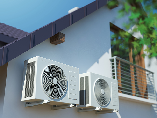 Air-conditioning inverter units on side of house