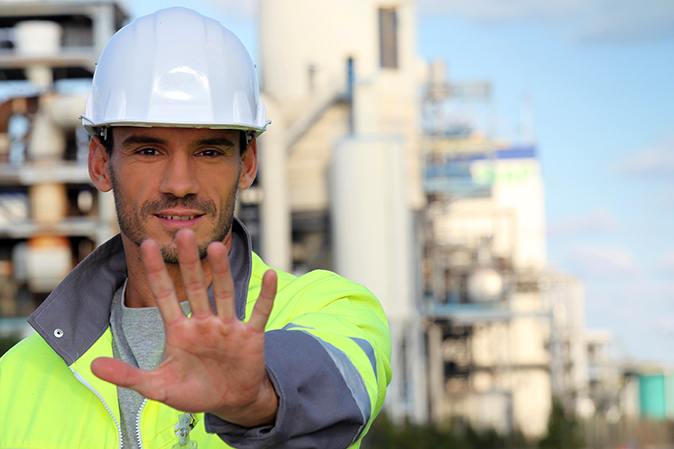 Site foreman with hand outstretched in 'stop' position