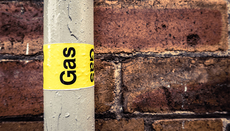 Gas pipe with yellow tape