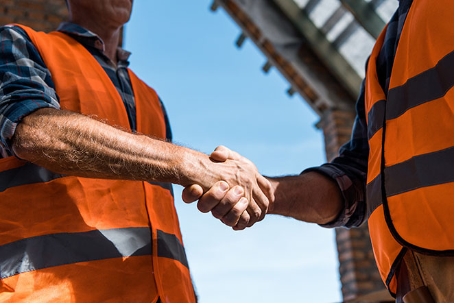 Workers shaking hands