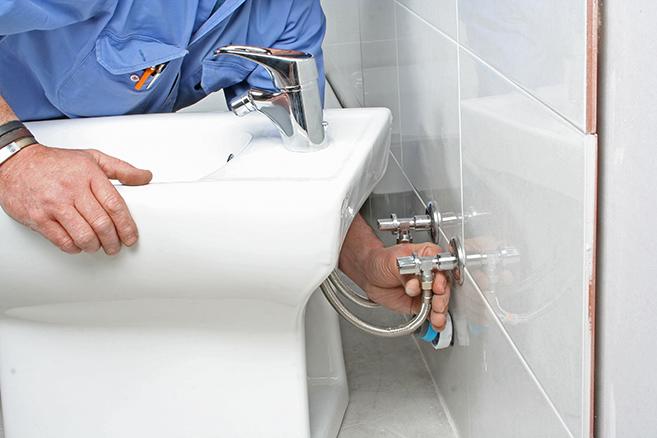 Plumber installing bidet