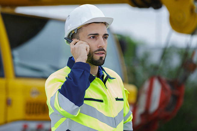 Builder talking on mobile phone